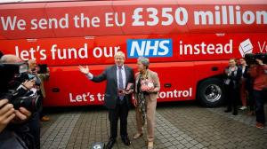 Brexit leader Boris Johnson in front of one of the many buses urging a Leave vote. Image via The Independent.